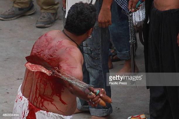 Pakistani Shiite Muslim flagellates himself during the mourning procession to mark the death anniversary of Imam Ali the soninlaw of Prophet Mohammad...