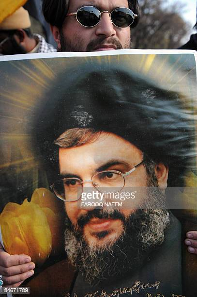 A Pakistani Shiite Muslim holds a placard of Hezbollah leader Hassan Nasrallah during a protest in Islamabad on February 6 2009 against the suicide...