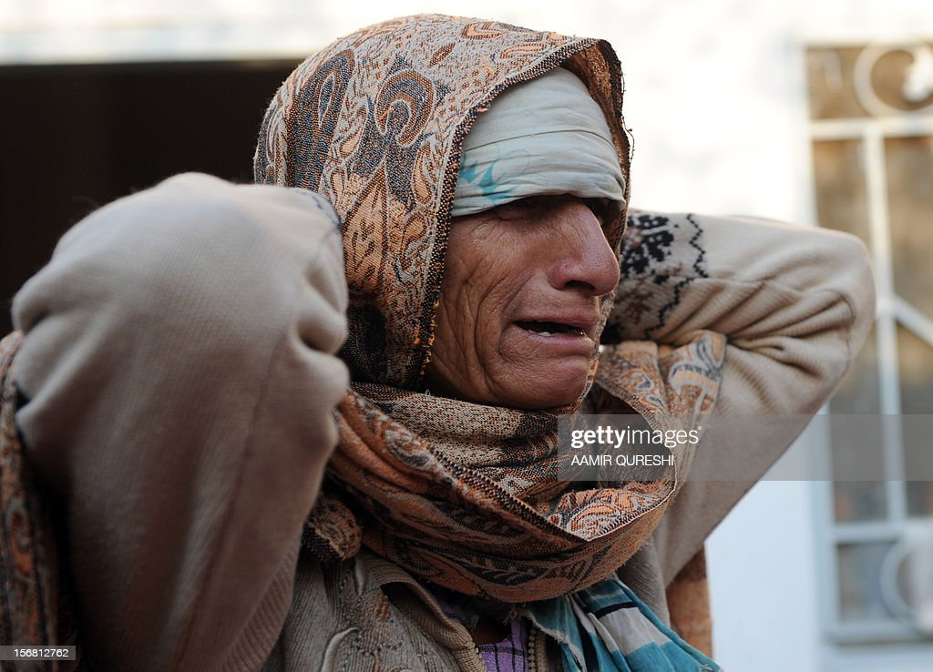 A Pakistani Shiite Muslim mouner cries after the killing of a relative following an overnight suicide bomb attack on minority Shiite Muslims procession in Rawalpindi on November 22, 2012
