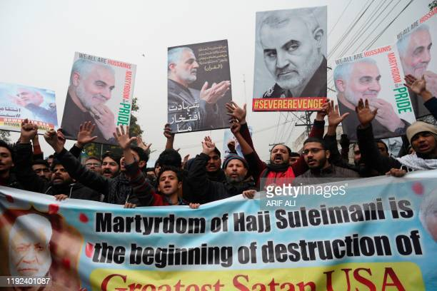 Pakistani Shiite Muslim protest against the killing of top Iranian commander Qasem Soleimani in Iraq outside the US consulate in Lahore on January 7...