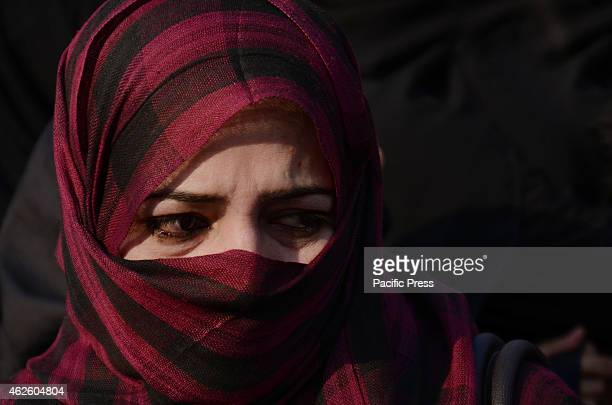 Pakistani Shiite Muslim weeps at the funeral of suicide attack victims in a Shiite mosque. Thousands of Shiites across Pakistan mourned and protested...