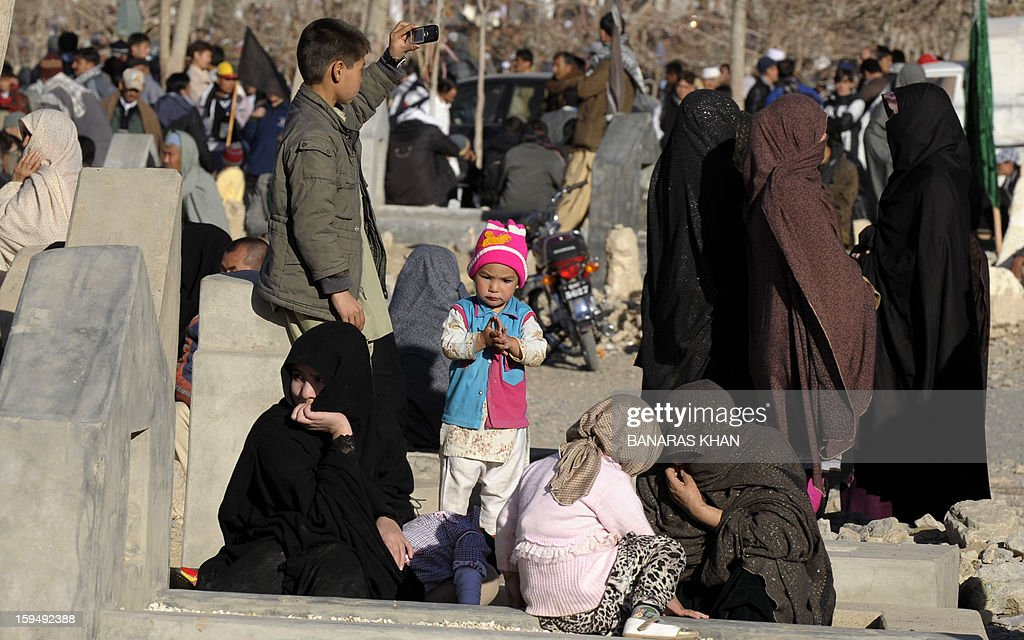 Pakistani Shiite Muslim women gather during the funeral ceremony of twin bomb blast victims in Quetta on January 14,2013. Embattled Shiite Muslims Monday buried victims of the deadliest single attack on their community in Pakistan, ending a four-day protest to demand protection after the provincial government was sacked. AFP PHOTO/Banaras KHAN