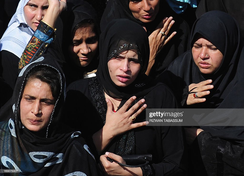 Pakistani Shiite Muslim women mourn during a funeral ceremony for bomb blast victims in Karachi on March 4, 2013. Thousands of Pakistanis attended funerals Monday for victims of a bombing that killed 48 people in a Shiite Muslim area of Karachi, the latest in a series of devastating attacks ahead of elections. AFP PHOTO/Rizwan TABASSUM