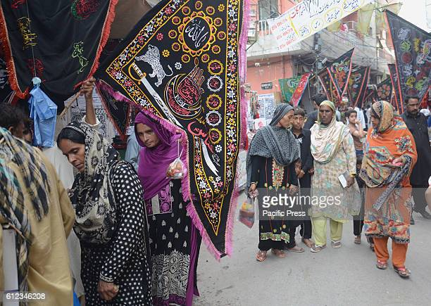 Pakistani Shiite Muslims are busy in purchasing related stuff from a vendor as part of the Holy month of Muharram ul Haram Muharram is known as the...