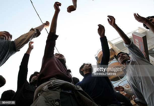 Pakistani Shiite Muslims beat their chests during a religious procession on the Ashura day of the holy Islamic month of Muharram at Raja Bazaar in...