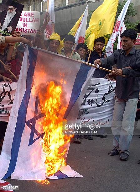 Pakistani Shiite Muslims burn an Israeli flag during a protest to mark the AlQuds day 03 October 2007 in Karachi Shiite Muslims held rallies across...