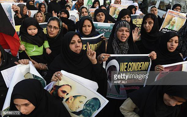 Pakistani Shiite Muslims carry placards depicting Ibrahim Zakzaky a Nigerian Shiite radical who wants to set up an Islamic Republic at a protest...