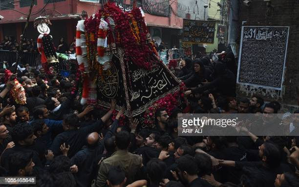 TOPSHOT Pakistani Shiite Muslims devotees take part in a religious procession to mark 'Arba'een' in Lahore on October 30 2018 Thousands of Shiite...