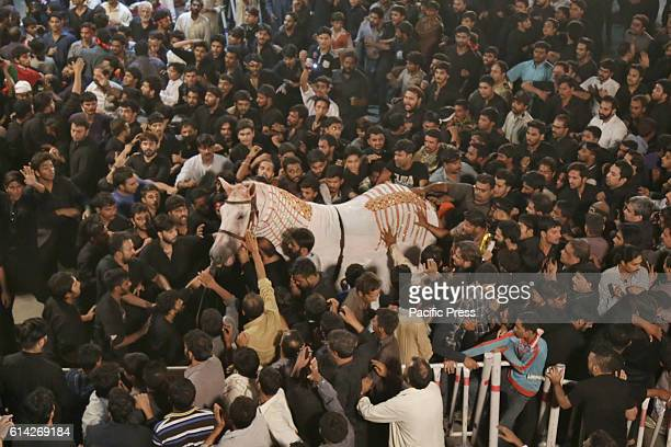 Pakistani Shiite Muslims gathered at Imam Bargah Karbabla Gamay shah during the Ashura procession on 10th Muharram al haram in Lahore Pakistan...