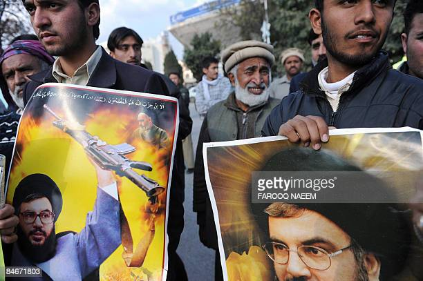 Pakistani Shiite Muslims hold placards of Hezbollah leader Hassan Nasrallah during a protest in Islamabad on February 6 2009 against the suicide...