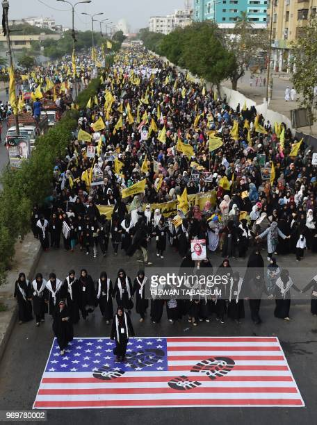 Pakistani Shiite Muslims march during a rally against Israel and the United States to mark the AlQuds during the holy month of Ramadan in Karachi on...
