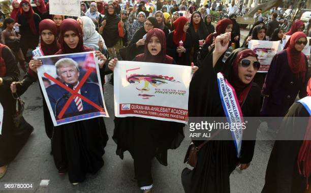 Pakistani Shiite Muslims march during a rally against Israel and the United States to mark the AlQuds during the holy month of Ramadan in Lahore on...
