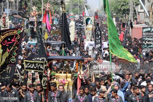Pakistani Shiite Muslims march during Ashura procession in Karachi Pakistan on September 21 2018