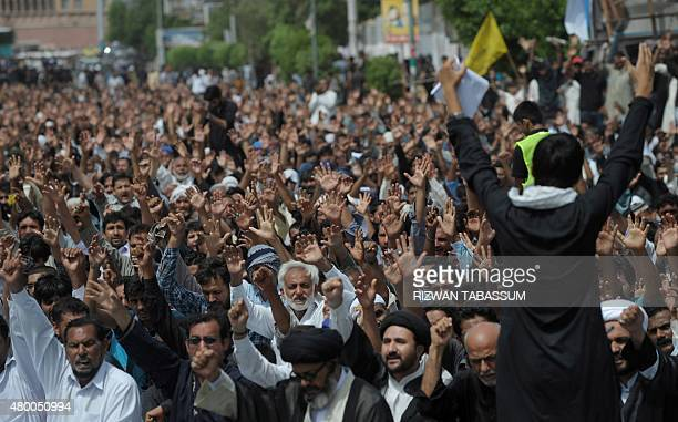Pakistani Shiite Muslims march in a procession to observe the death anniversary of Imam Ali the soninlaw of Prophet Mohammad in Karachi on July 9...