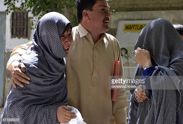 Pakistani Shiite Muslims mourn the killing of their relatives outside a hospital following an attack in Quetta on April 27 2015 Two Pakistani Shiite...