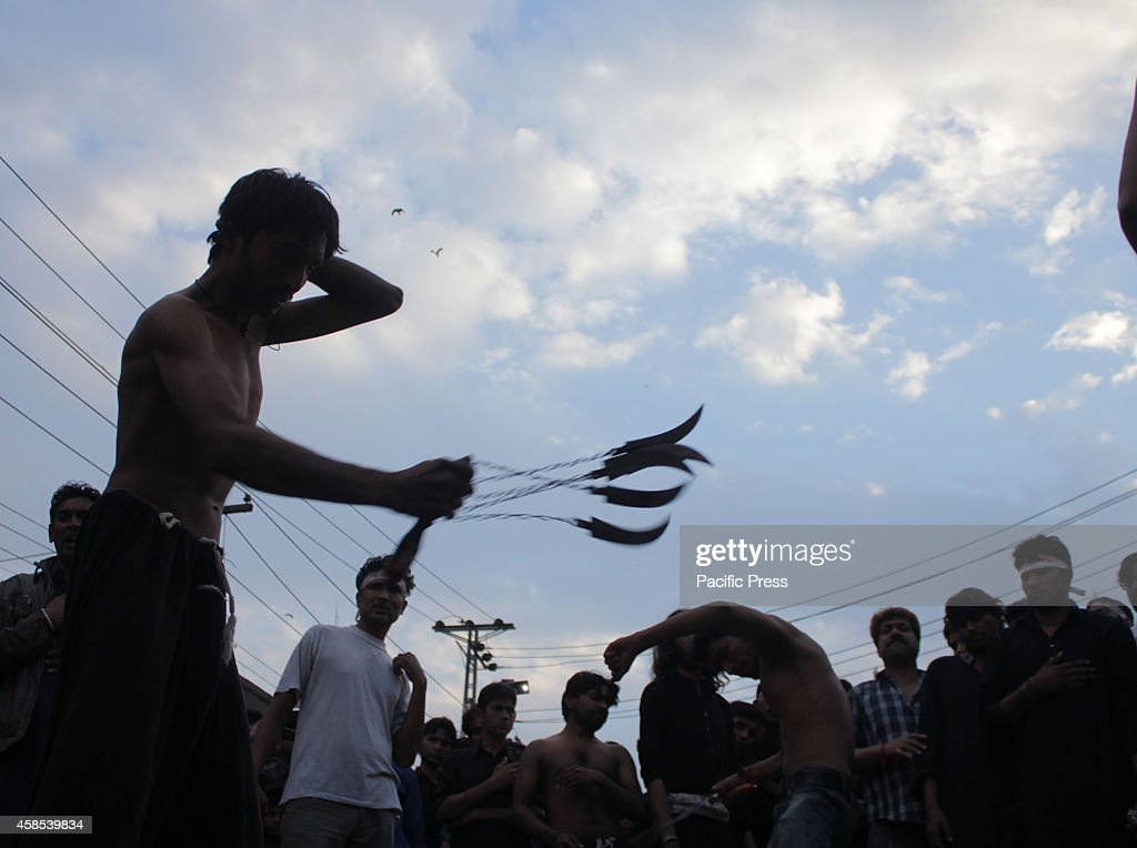 Pakistani Shiite Muslims Observing Self Flagellation With