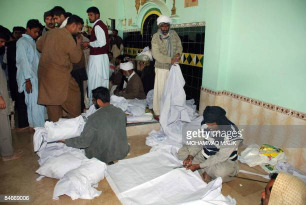 Pakistani Shiite Muslims prepare coffins for the victims of a suicide attack at a mosque in Dera Ghazi Khan on February 6 2009 Shiite mobs staged...