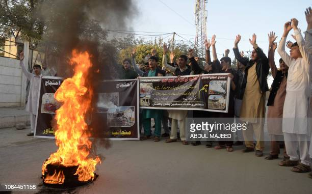 Pakistani Shiite Muslims shout slogans during a protest following a suicide blast in Hangu market in Peshawar on November 23 2018 At least 31 people...