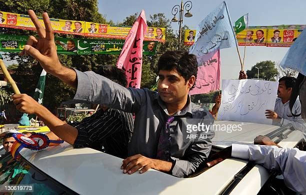 Pakistani singer Abrarul Haq flashes the victory sign as he leads a rally in Lahore on October 27 2011 Around 400 people joined the 'Save Pakistan...