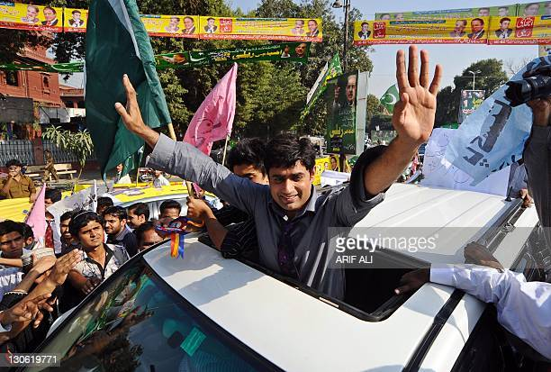 Pakistani singer Abrarul Haq waves to supporters as he leads a rally in Lahore on October 27 2011 Around 400 people joined the 'Save Pakistan rally'...