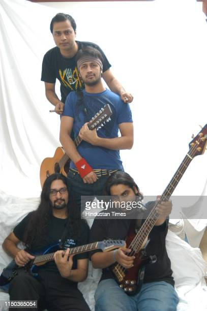 Pakistani singer Atif Aslam with his band members during a photoshoot on June 29 2007 in New Delhi India