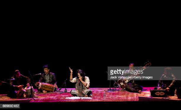 Pakistani singer Sanam Marvi leads her ensemble as they perform onstage during a concert of Sufi music at the BAM Howard Gilman Opera House New York...