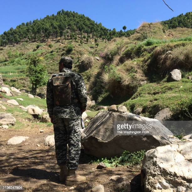 Pakistani soldier guards an area near the site where Indian jets tried to strike a suspected militant camp in February