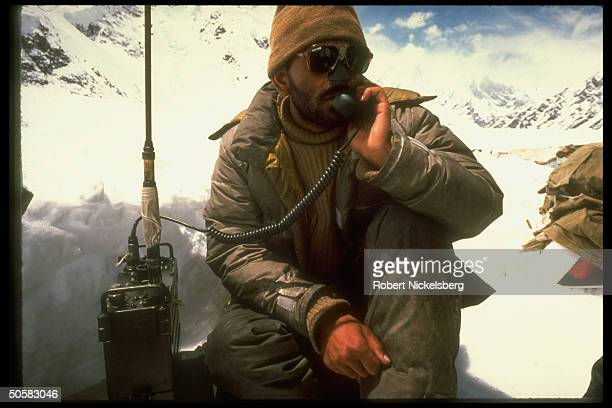 Pakistani soldier in sunglasses manning radio phone at Himalayan glacier army outpost during 5yrold Indian/Pakistani border dispute over icy...
