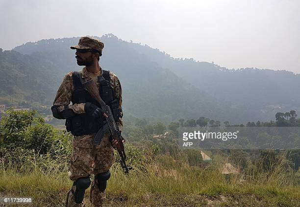 A Pakistani soldier patrols a village in district Bhimber near the Line of Control in Pakistanadministered Kashmir during a media trip organised by...