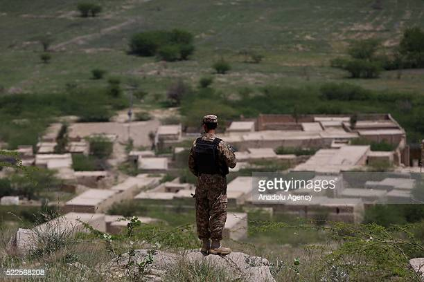 A pakistani soldier stands guard around the Mir Ali district of North Waziristan Pakistan on April 20 2016 Largescale military operations against...