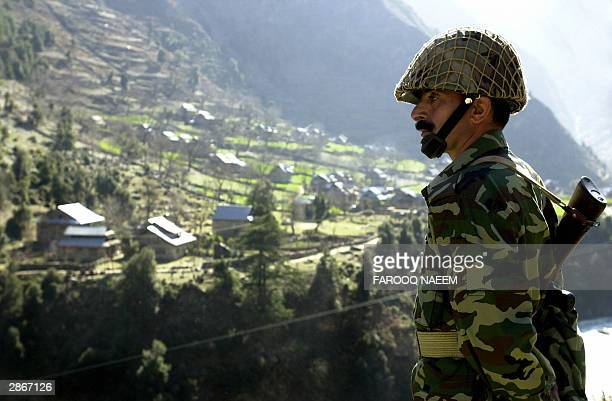 Pakistani soldier stands guard at the Line of Control that divides the disputed Himalayan State of Kashmir between India and Pakistan at the village...