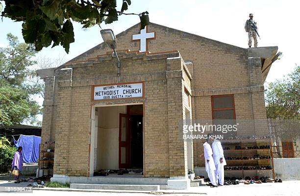 A Pakistani soldier stands guard on a roof at a Church in Quetta on September 22 following two suicide bomb attacks on a Church in Peshawar A twin...