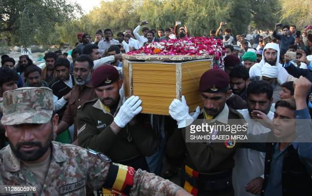 Pakistani soldiers and residents carry the coffin of Pakistani soldier Khurram Ali who was killed in a gunfight between Indian and Pakistan troops on...
