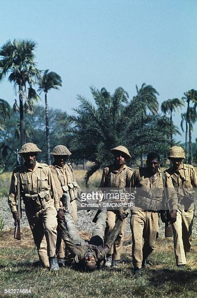 Pakistani soldiers carry the corpse of an Indian officer killed during the war for Bangladeshi independence