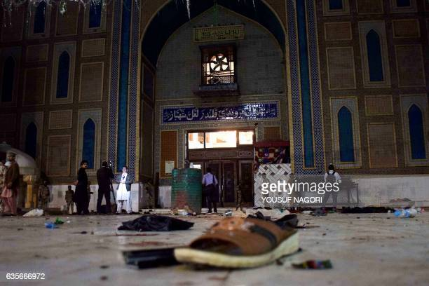 TOPSHOT Pakistani soldiers cordon off the shrine of 13th century Muslim Sufi Saint Lal Shahbaz Qalandar after a bomb blew up in the town of Sehwan in...