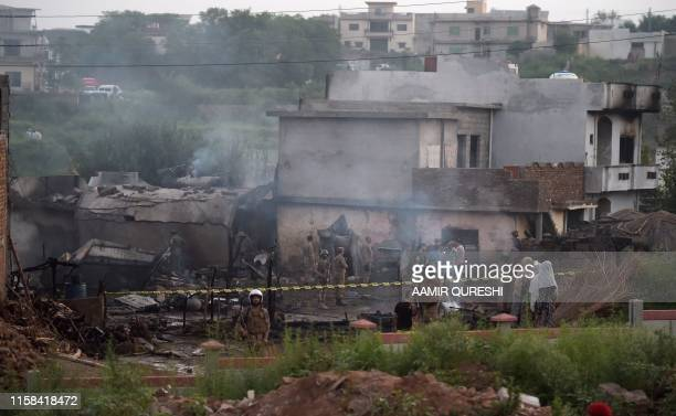Pakistani soldiers cordon off the site where a Pakistani Army Aviation Corps aircraft crashed in Rawalpindi on July 30 2019 Fifteen people were...