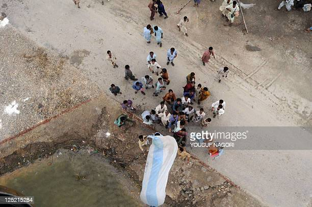 Pakistani soldiers drop relief food bags from a helicopter in the floodaffected area of Badin on September 16 2011 The United Nations said that it...