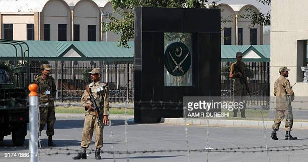 Pakistani soldiers guard the main entrance to army headquarters during a visit by Army Chief General Ashfaq Kayani in Rawalpindi on October 11 2009...