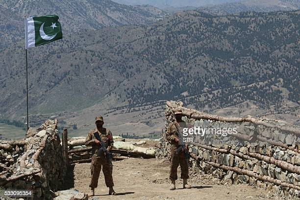 Pakistani soldiers keep vigil from a post on top of a mountain in the former Taliban militants strong hold border area in Shawal valley on May 20...