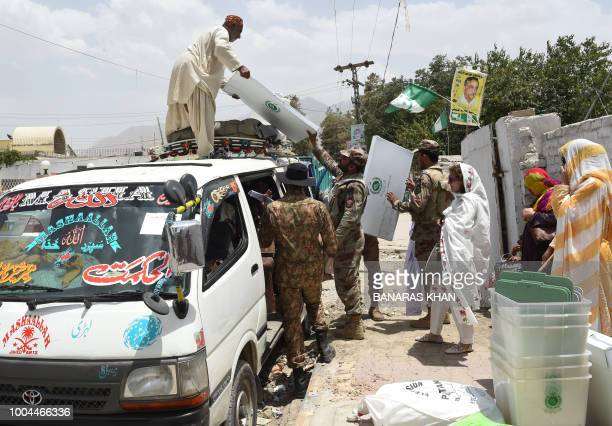 Pakistani soldiers load ballot boxes and voting materials on a vehicle outside a distribution centre in Quetta on July 24 2018 Pakistan will hold its...