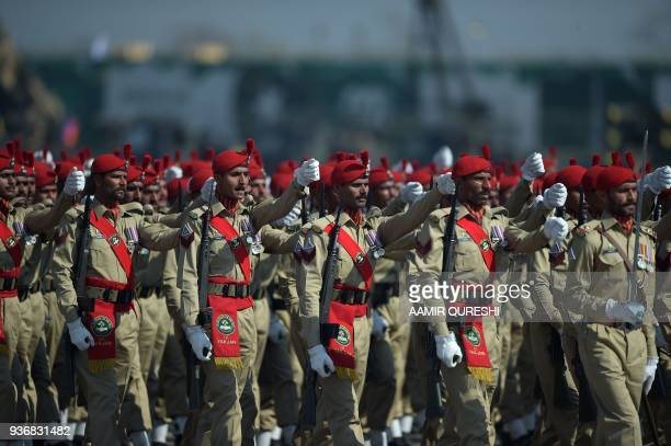 Pakistani soldiers march past during the Pakistan Day military parade in Islamabad on March 23 2018 Pakistan National Day commemorates the passing of...