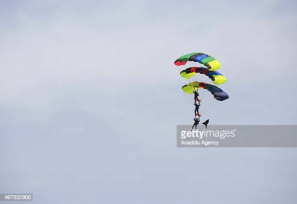Pakistani soldiers parachute from helicopters during the Pakistan National Day celebrations in Islamabad on March 23 2015 Pakistan holds its first...