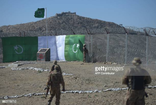 Pakistani soldiers patrol next to a newly fenced border fencing along with Afghan's Paktika province border in Angoor Adda in Pakistan's South...
