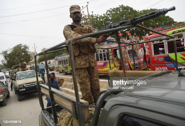 Pakistani soldiers patrol on a street in the port city of Karachi on July 24 2018 Pakistan's military fanned out across the country ahead of the July...