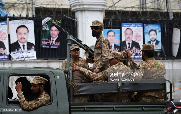TOPSHOT Pakistani soldiers patrol outside a voting material distribution centre in Lahore on July 24 2018 Pakistan will hold its general election on...