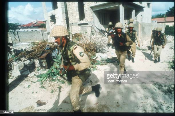 Pakistani soldiers patrol the area December 6 1993 in Mogadishu Somalia US gunships attacked the compound of warlord Mohammad Aidid in response to...