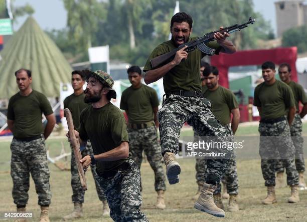 Pakistani soldiers perform during a ceremony to mark the country's Defence Day in Peshawar on September 5 2017 Pakistan on September 6 will celebrate...