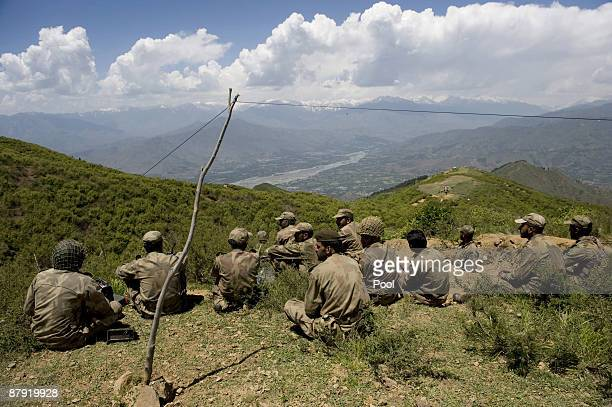 Pakistani soldiers seat on top of a mountain at Banai Baba Ziarat area on May 22 2009 in northwest Pakistan Troops took control of the mountain used...