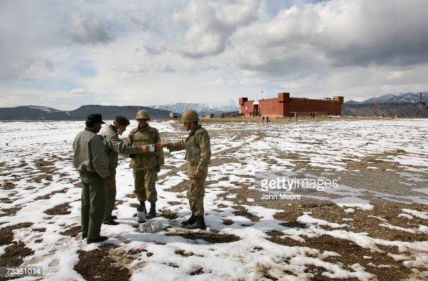 Pakistani soldiers share tea near a Pakistani border outpost in the North Waziristan tribal area February 17 only a few hundred meters from...