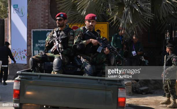 Pakistani soldiers sit in a vehicle as they patrol at an entry gate of The Gaddafi Cricket Stadium in Lahore on March 5 on the final cricket match of...